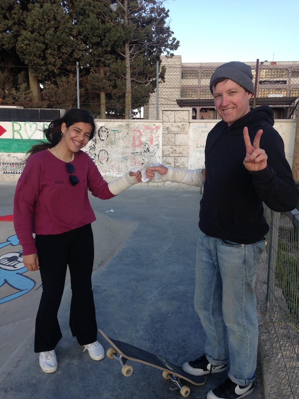 Michael Skinner with a Palestinian girl at a skatepark in Asira, West Bank
